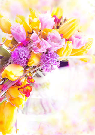 Holiday  Beautiful spring flowers - yellow tulips as festive background photo