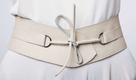buckle: Fashion  Women s beige leather wide belt with lacing Stock Photo