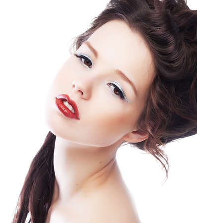 Beauty  Beautiful woman face with chic red lips close up  Bright makeup  Hairstyle photo