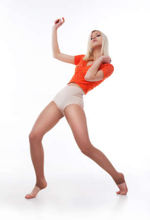 Dance  Hip-hop style female dancer posing over white background