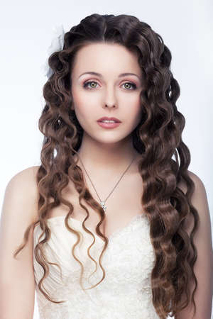 smooth hair: Beautiful  fashion model brunette  Hair, makeup, styling and retouching by professionals