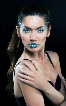 Fashion concept  Beauty woman face with bright blue makeup photo