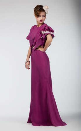 Beauty portrait of an elegant stylish woman in long fashion dress photo