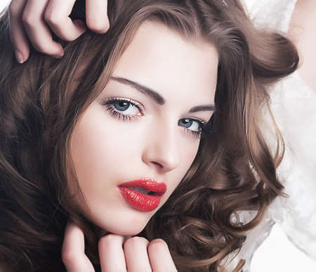 Closeup beautiful brunette woman face with sexy red lips  Sensual make-up Stock Photo - 13520492