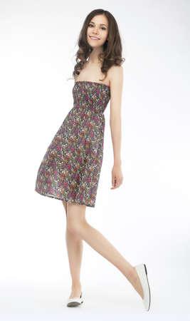 Pretty brunette girl wearing short fashion dress over white background Stock Photo - 13714195