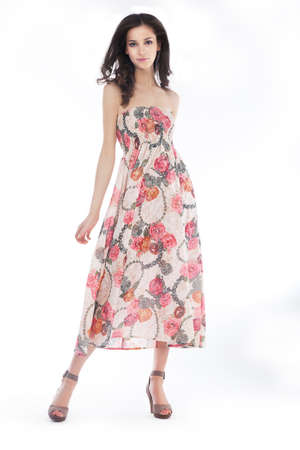 Young pretty woman in elegant light fashion dress, studio shot, series of photos Stock Photo - 13714190