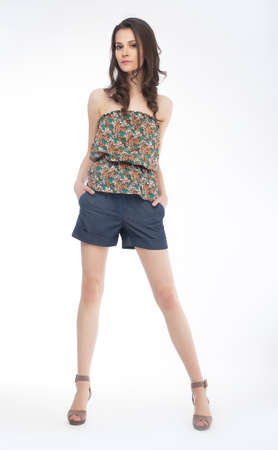 Elegant fashionable woman in shorts posing in studio photo