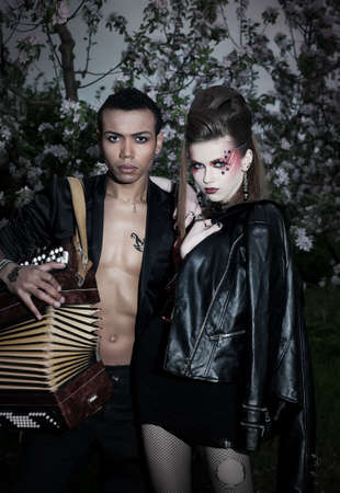 Portrait of a couple people - punk woman and black man musician photo