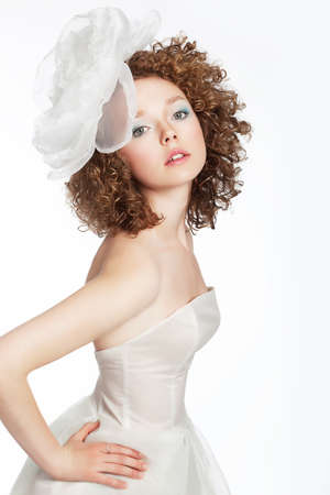 sexy bride: Beautiful young woman bride posing in white wedding dress with bow Stock Photo