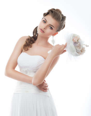 bridal veil: Beautiful girl in wedding dress isolated on white