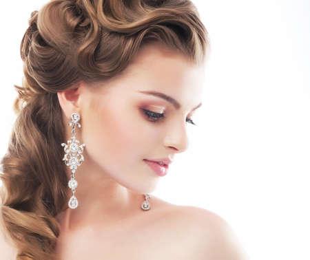 Portrait of beautiful female wedding model isolated on white background photo