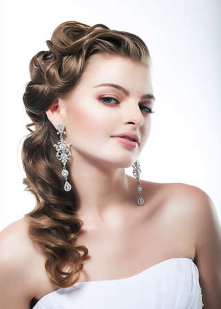 bridal hair: Beautiful bride in white dress  Festive coiffure and makeup Stock Photo