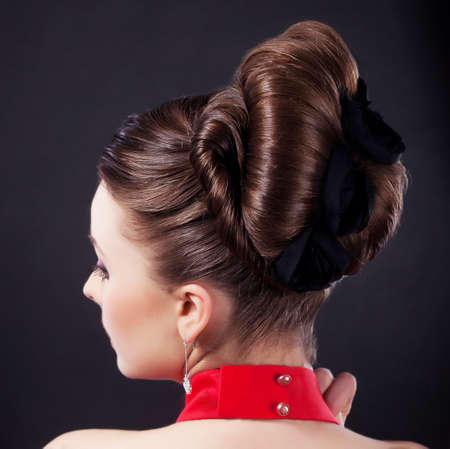 Rear view of a beautiful coiffure  Pigtails  Braid  Backside studio shot  photo