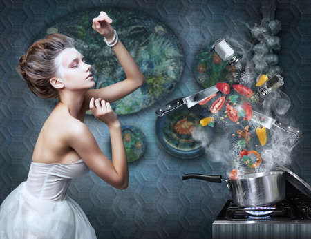housekeeping: Beautiful emotional woman in kitchen interior cooking  Art  Creative concept
