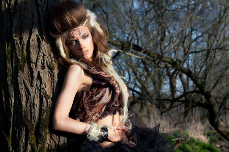 Portrait of romantic woman in fairy forest  Renaissance style  Nature scenic  Masquerade photo