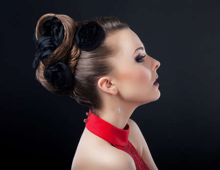 Beautiful young woman face with creative plait hairstyle looking photo