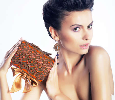Beautiful woman model in oriental style make-up  Accessories, jewelry, luxury box, earrings photo