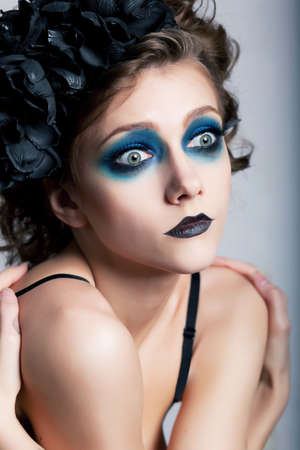 Girl with bright unusual conceptual make-up  painted face  closeup portrait Stock Photo - 14420791