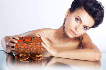 Attractive young woman with jewellery luxury box - clean healthy skin Stock Photo - 14460330