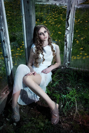 Young dreamy girl in white fashion dress sitting on porch  Nature  Rural scene  Terrace Stock Photo - 14516715
