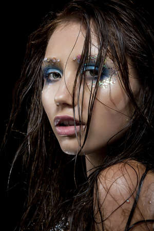 adult mermaid: Portrait of young woman with creative make-up in mermaid style  Wet hair Stock Photo