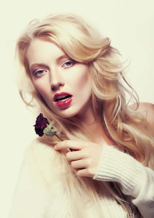 Sexy woman blonde with flower - red rose Flowers  Sepia vintage toned photo