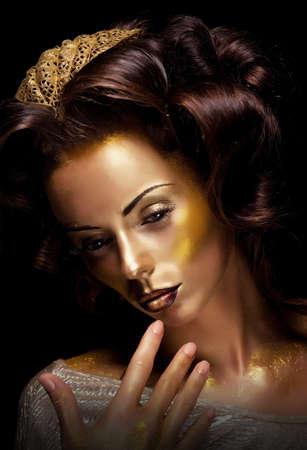 painted face mask: Paint  Fantasy  Glamor  Creative gold make-up, beauty woman face and fashion style