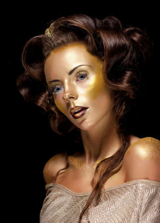 glamour luxury: Fashion style  Art  Waxen gold gilt woman face - glamour luxury makeup Stock Photo