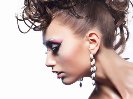 Fashion woman - bright unusual hairstyle, earrings and vibrant stylish make-up photo
