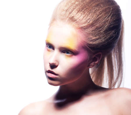 Beautiful blonde woman face with bright colorful make-up photo