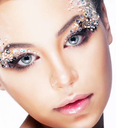Cosmetics and make-up, beauty and fashion  Close-up portrait of beautiful woman with bright glamour make-up, clean skin photo