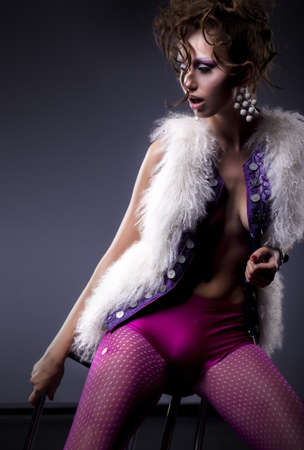 Glamor fantasy style - sexy girl in punk stockings and white fur vest posing Stock Photo - 15488768
