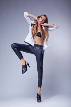Flirting fashion provocative woman in stylish trousers - dance photo