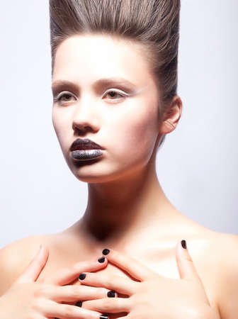 Fashion girl with creativity makeup and hairstyle posing Stock Photo - 15331956