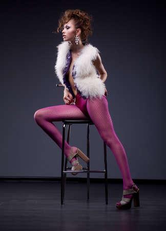 pantyhose: Fashionable glamorous woman sitting on chair in studio