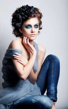 Creative woman face - bright color makeup. Fashion conceptual style photo