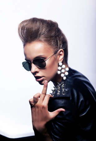 provocation: Bright beautiful young woman in fashion sunglasses indicating her finger