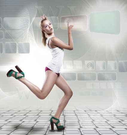 Happy shopping fashion woman running on keyboard touching web sensor icons - www technology design photo
