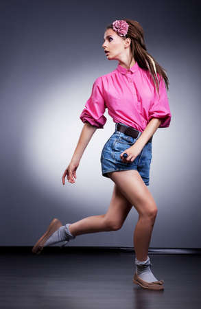 Woman in denim blue shorts posing in studio - fashion style Stock Photo - 15483167