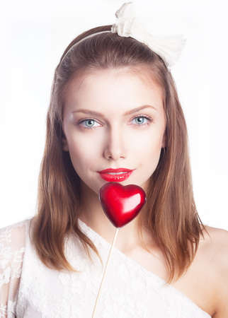 Beautiful smiling woman holding red heart shape symbol - valentines day concept Stock Photo - 15413563