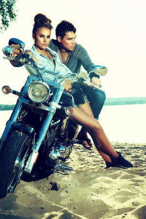 motorbikes: Two people on motorbike resting themselves on trip