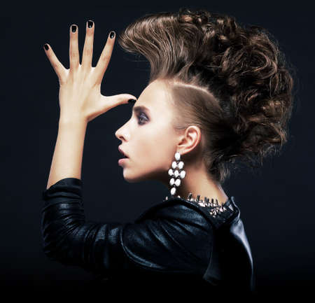 high fashion: Stylish woman with styling pigtails, creative hairstyle, saluting  Isolated on black