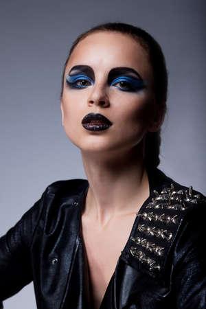 arrogant: Beautiful stylish brunette arrogant woman with blue eyes make up
