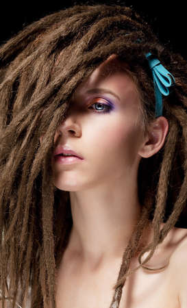Fashion hairstyle with dreads - beautiful teen girl face photo