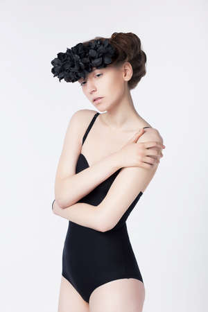 Theatrical glamour style - sensual dramatic woman in black wreath photo