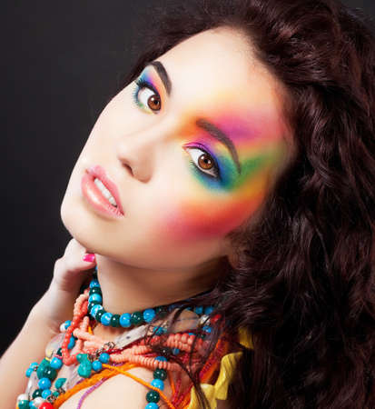 Creative multicolored make up - fashionable beauty woman painted face photo