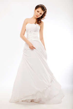 Beautify fiancee in luxurious white wedding long dress posing photo