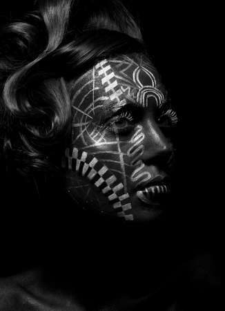 aboriginal woman: Savage religious woman voodoo with ornamental tattoo. Tribe person. Painted face