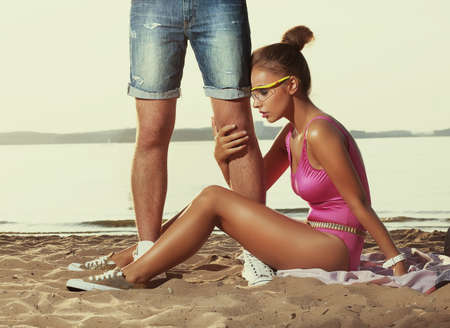 Divorcement, treason - disappointed young woman hugging men's legs Stock Photo - 15867524