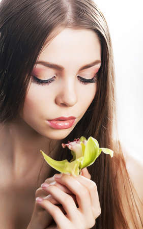 Sensual beaty woman with flower, fresh orchid photo